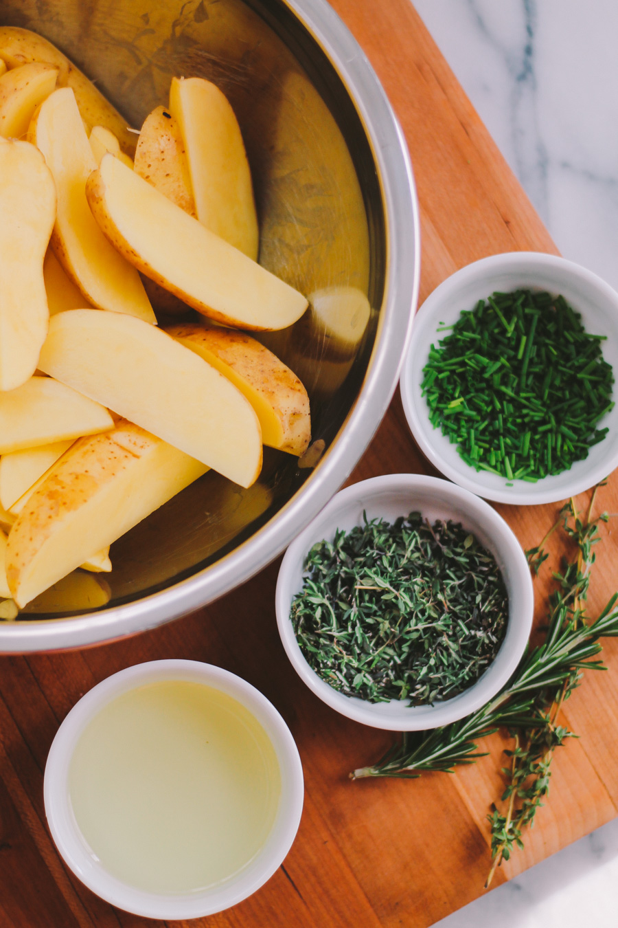 grilled fries with fresh herbs & lemon pesto aioli via playswellwithbutter.com
