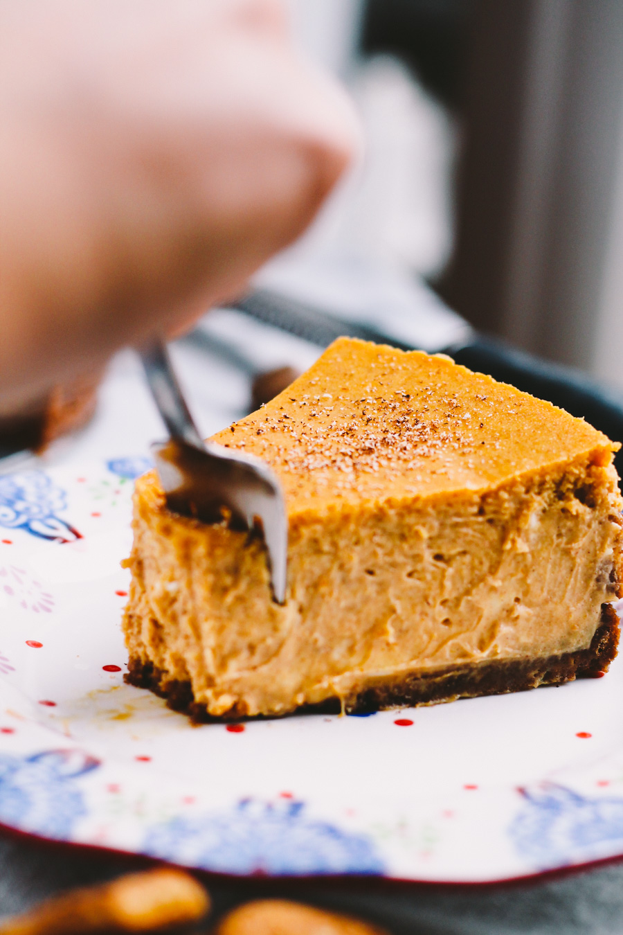 perfect pumpkin cheesecake with gingersnap crust via playswellwithbutter | an amazingly light & fluffy cheesecake that packs a punch of pumpkin flavor. it will be the perfect update this holiday season to pumpkin pie at your thanksgiving, friendsgiving, or christmas table!