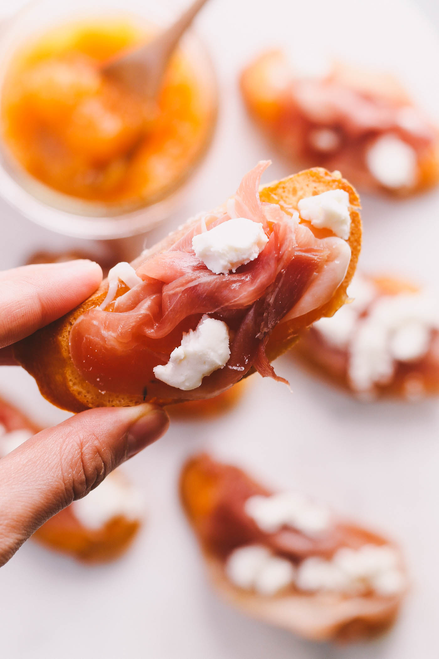simple homemade crostini topped with salty prosciutto, tangy goat cheese, & an easy homemade cantaloupe & honey jam. these 4-ingredient crostini are just as simple as they are elegant. perfect to serve as an appetizer at your next dinner party or to bring along with you to any summer parties you have this year! | appetizer recipe, easy appetizer, appetizer idea, dinner party, summer recipe, easy entertaining, girls night, date night, crostini, cantaloupe |