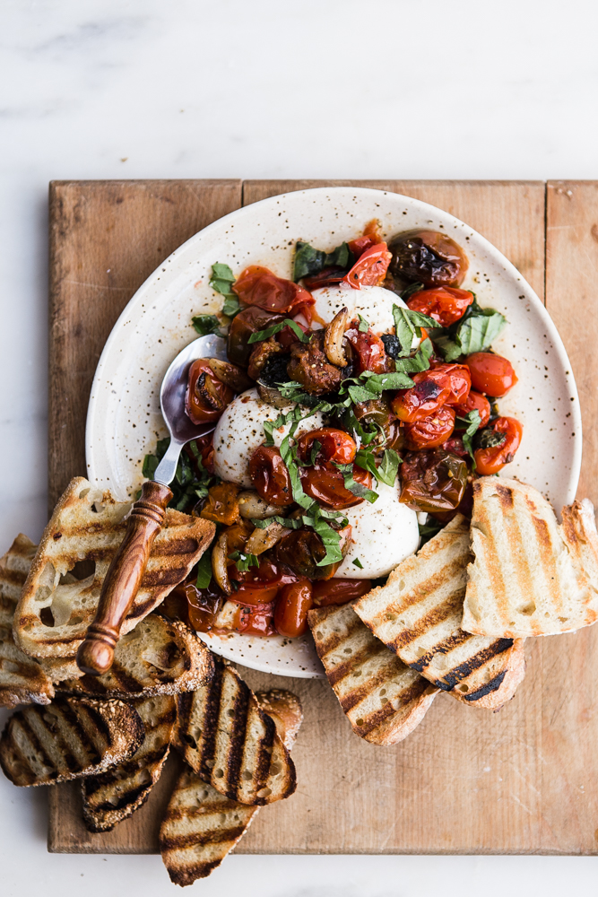 braised tomatoes with burrata + 50 recipes for perfect for summer parties! | summer food, summer parties, summer recipes, summer appetizers, summer desserts, summer drinks, easy entertaining, entertaining tips |
