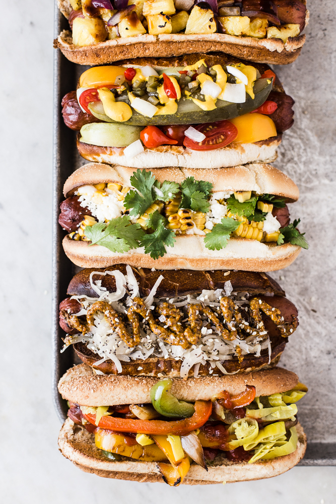 hot dog bar with tons of toppings + 50 recipes for perfect for summer parties! | summer food, summer parties, summer recipes, summer appetizers, summer desserts, summer drinks, easy entertaining, entertaining tips |