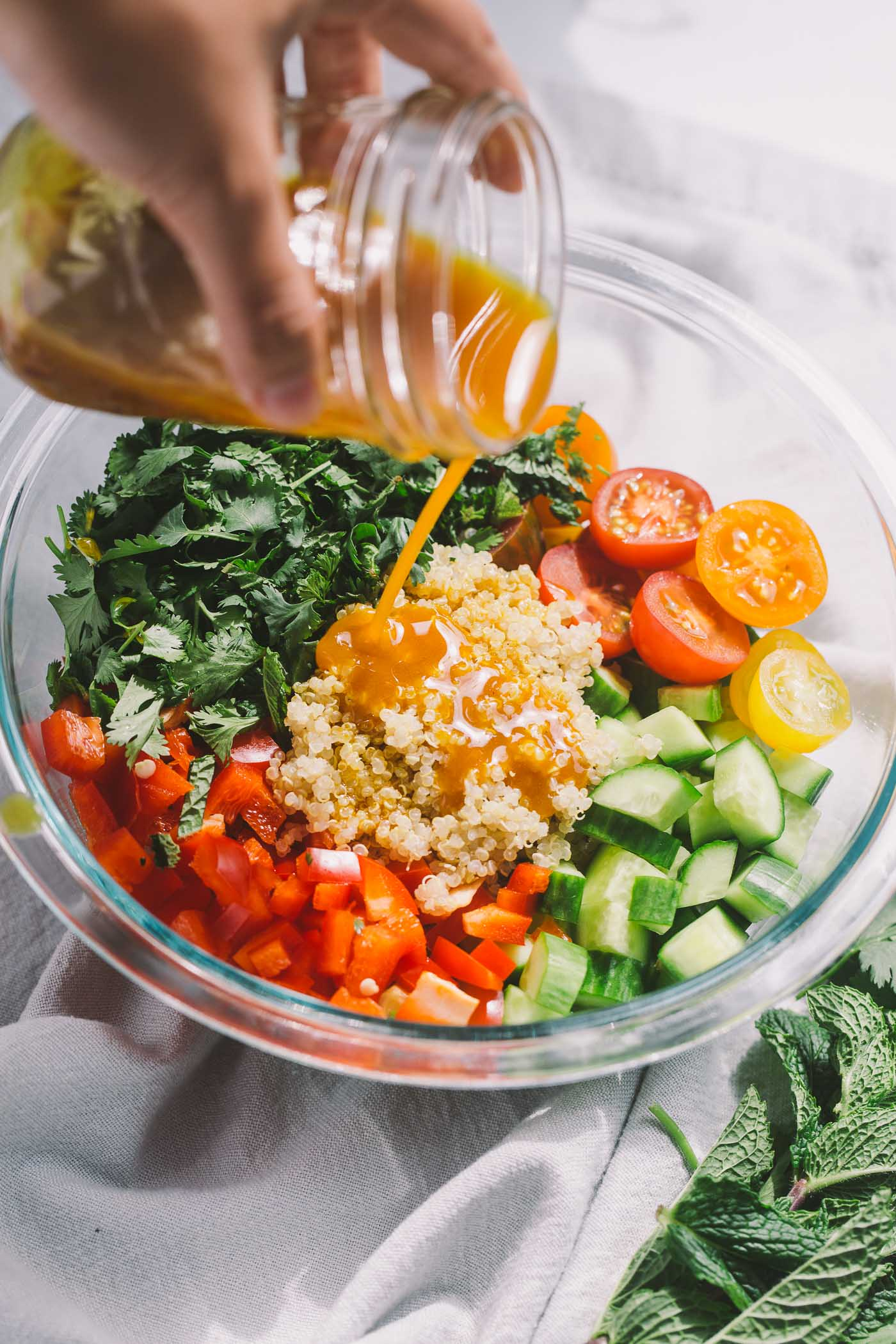 equal parts entrée salad & nourishing bowl, summer glow bowls are end of summer perfection. the best produce of the season (kale, arugula, red bell pepper, cucumber, heirloom tomatoes) is tossed with quinoa, fresh herbs, & a homemade curry vinaigrette. summertime, perfected!