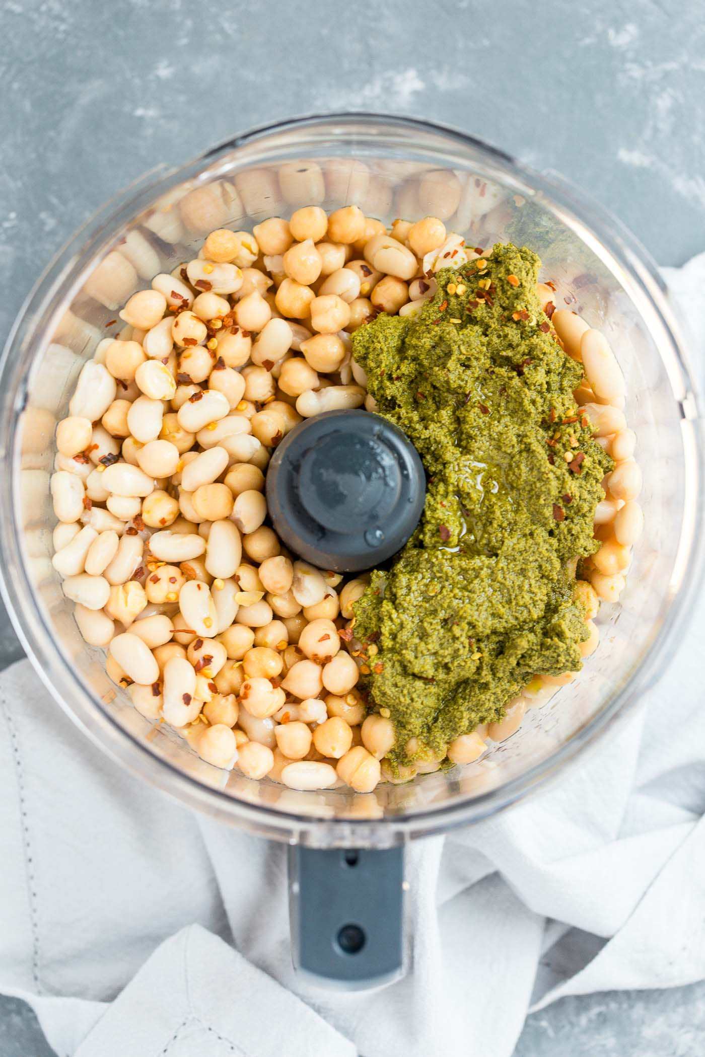a creamy, dreamy, totally addictive white bean pesto hummus loaded with the bright flavors of pesto & lemon. perfect for healthy end-of-summer snacking, an easy appetizer to bring to potlucks, or the perfect snack to bring to a football party!
