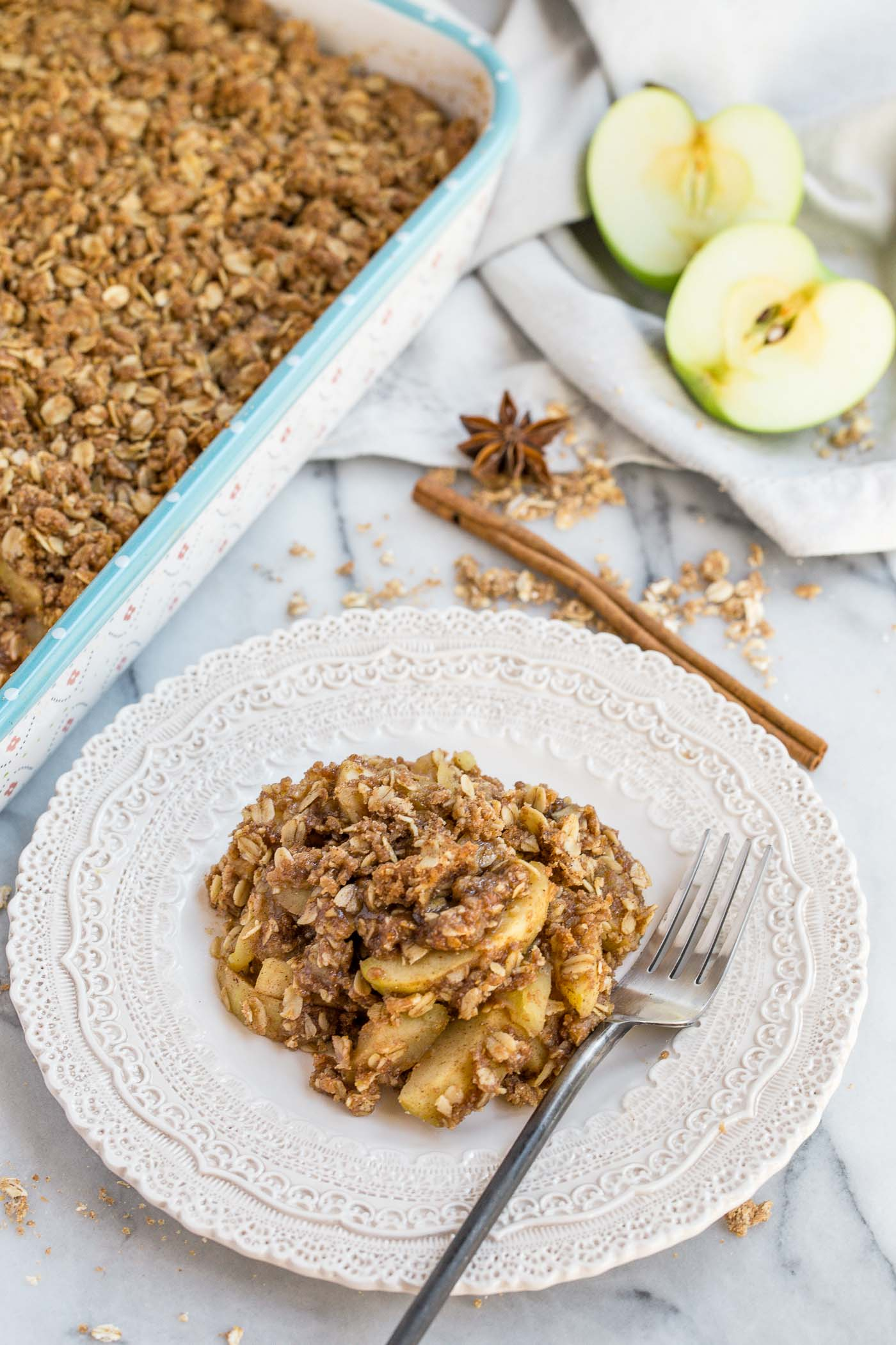 a classic apple crisp updated with the warm flavors of chai, this chai spiced apple crisp is loaded with chai flavor! crisp granny smith apples tossed in a chai spice blend of cinnamon, cardamom, nutmeg, ginger & allspice & baked under a generous layer of homemade crisp. the perfect cozy fall dessert to celebrate all things autumn (especially served warm with a scoop of vanilla ice cream…). #playswellwithbutter #chaispice #applecrisp #chaiapplecrisp #fallbaking #applerecipes