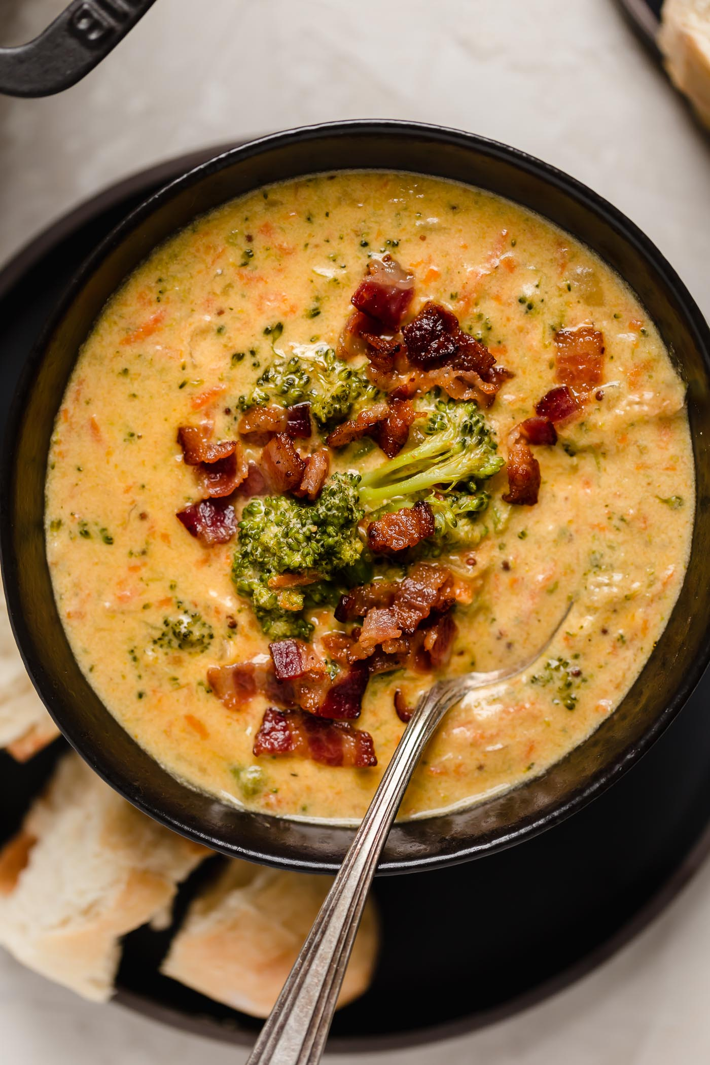 bacon beer cheese broccoli cheddar soup. a cross between two classic comforting soups, beer cheese soup & broccoli cheese soup, this bacon beer cheese broccoli cheddar soup is thick, luscious, creamy, & decadent made with @Tillamook Farmstyle Cut Sharp Cheddar Shredded Cheese. the ultimate comfort food dinner to warm you up on a cold night this winter! #playswellwithbutter #broccolicheddarsoup #broccolicheesesoup #bestbroccolicheesesoup #creamybroccolicheesesoup #beercheesesoup #bestbeercheesesoup #baconbeercheesesoup #comfortfood #comfortfoodrecipes #ad #Tillamook_Partner #TillamookCheese