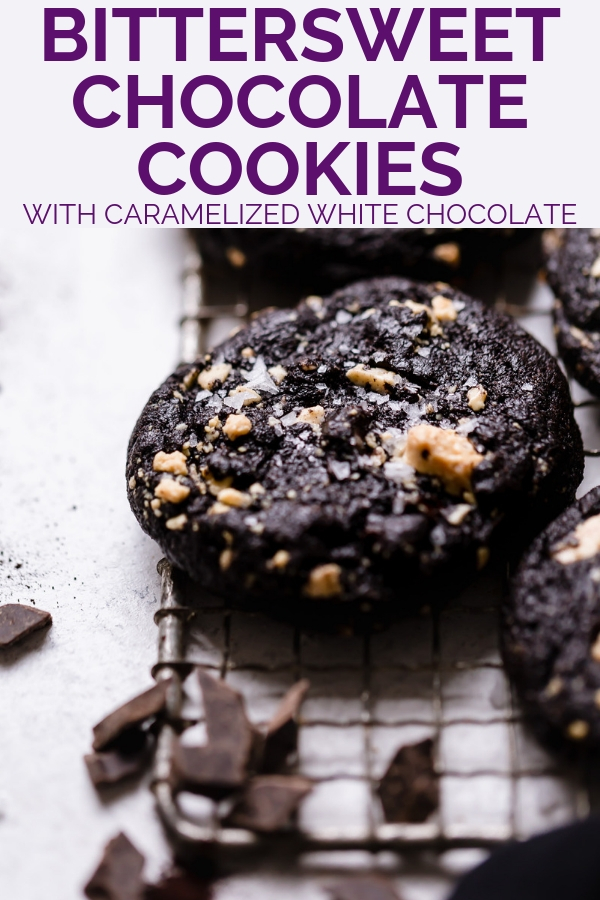 bittersweet chocolate cookies with caramelized white chocolate. intensely fudgy dark chocolate cookies made with black cocoa powder, filled with caramelized white chocolate chunks & bittersweet chocolate chunks & finished with flaky sea salt. these bittersweet chocolate cookies are dramatic, rich & decadent! #playswellwithbutter #cookierecipe #chocolatecookie #doublechocolatecookie #fudgychocolatecookie #blackcocoapowderrecipes #caramelizedwhitechocolate