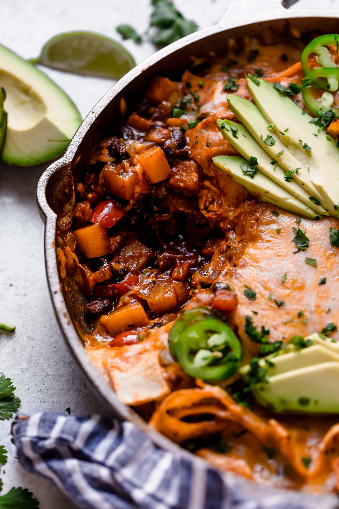 this vegetarian enchiladas skillet is filled with butternut squash, black beans, corn tortilla strips, & a generous layer of melty cheddar cheese. the best part? these vegetarian enchiladas only take 25 minutes to make. weeknight enchiladas for the win! #playswellwithbutter #vegetarianenchiladas #blackbeanenchiladas #skilletenchiladas #vegetarianrecipes #vegetarianrecipesforbeginners #vegetarianenchiladas #easyvegetarianenchiladas #butternutsquash #enchiladas #skilletmeals #easyskilletrecipe