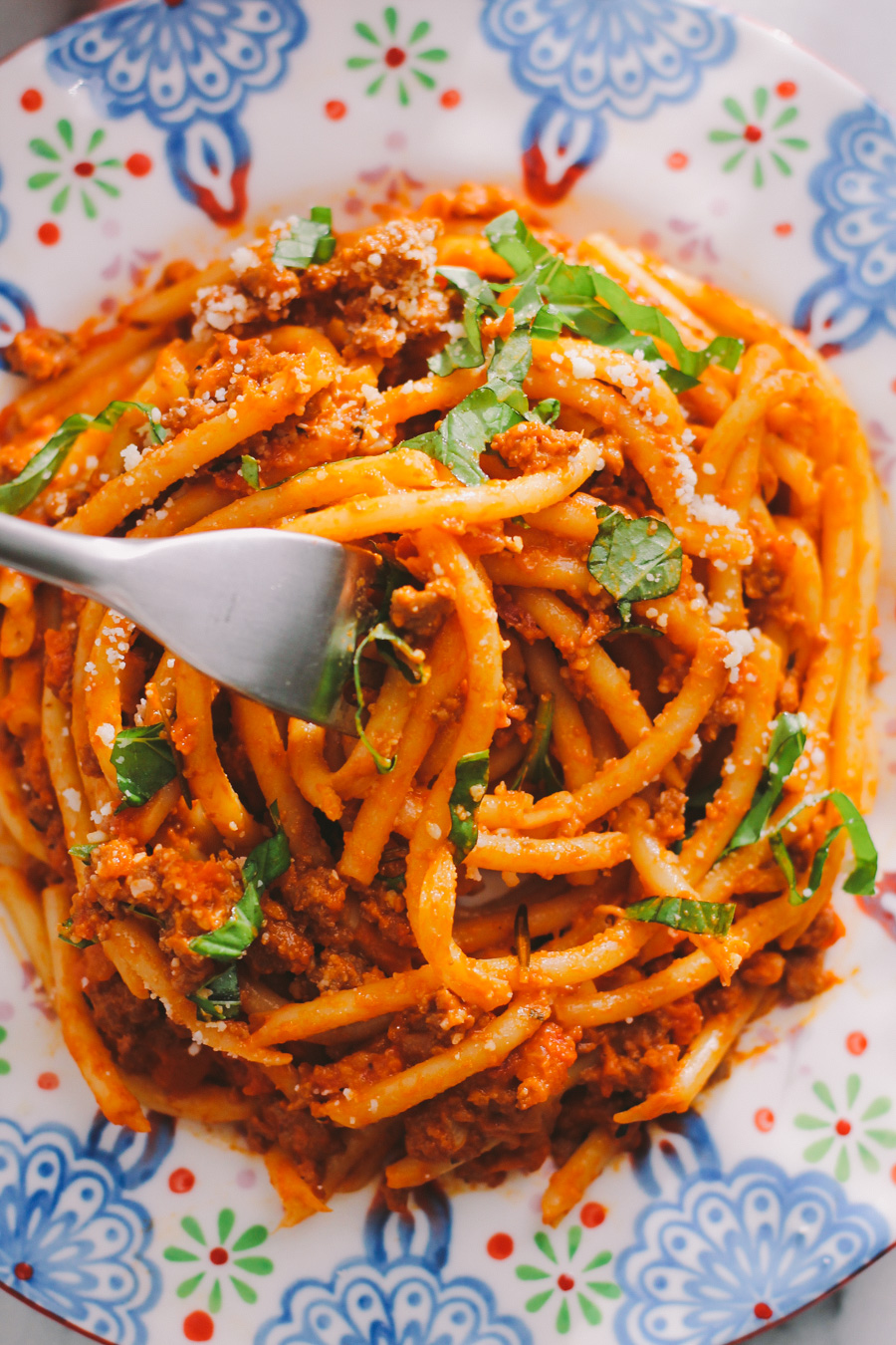 "pasta bolognese with bucatini via playswellwithbutter | classic italian comfort food lightened up as a ""fauxlognese"" by using ground turkey & tons of veggies without compromising any of the flavor! bring an authentic taste of italy into your home with zero guilt!"