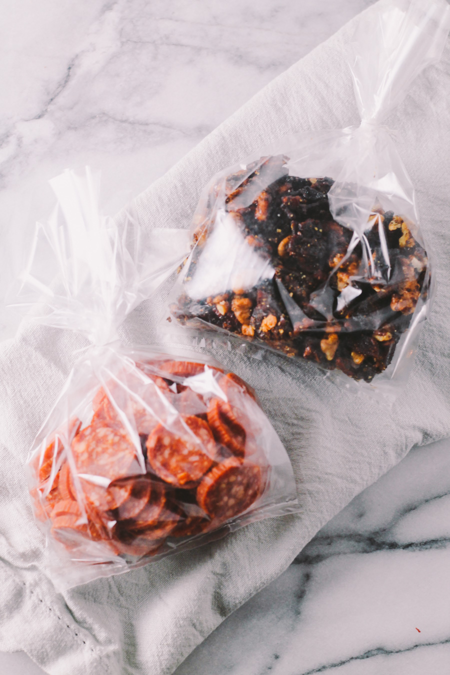 homemade beer gift basket essential #3: bar snacks - spicy candied bacon nuts & spicy salami | treat the beer lover in your life with a homemade beer gift basket this holiday season with the plays well with butter holiday gift basket series! pair a few great bottles of craft beer with a couple of festive beer glasses & a few handmade bar snacks & you'll totally knock the socks off of any beer nerd! | a plays well with butter holiday gift basket series homemade holiday gift basket for the beer lover in your life