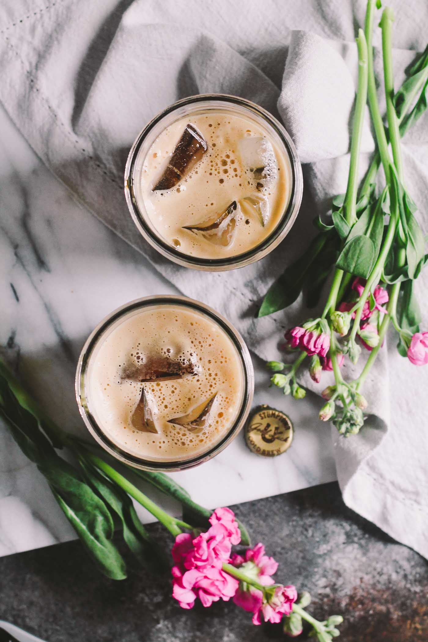 porter cold brew iced coffee is a rich & creamy iced coffee cocktail perfect for springtime & summer weekend brunch vibes! the intense coffee flavor of cold brew coffee meets its perfect match in the slightly sweet & roasty flavors of dark porter beer. porter cold brew iced coffee will be your go-to coffee treat this summer!   cold brew coffee, brunch cocktail recipe, coffee cocktail recipe, spiked coffee, iced coffee  