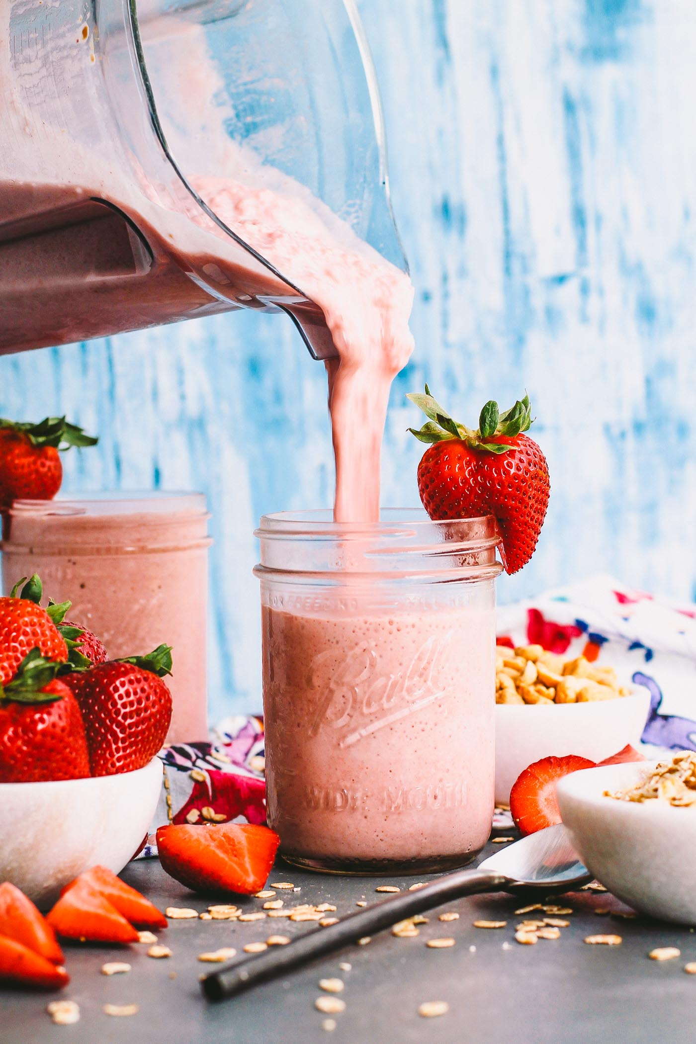 a creamy, delicious smoothie recipe for an easy, healthy breakfast for any busy weekday mornings! these peanut butter & jelly strawberry smoothies are loaded with strawberries, peanut butter, & oats to keep you full until lunchtime. | smoothie, healthy smoothie, protein shake, healthy breakfast, smoothie pack, gluten free, vegan, iifym |