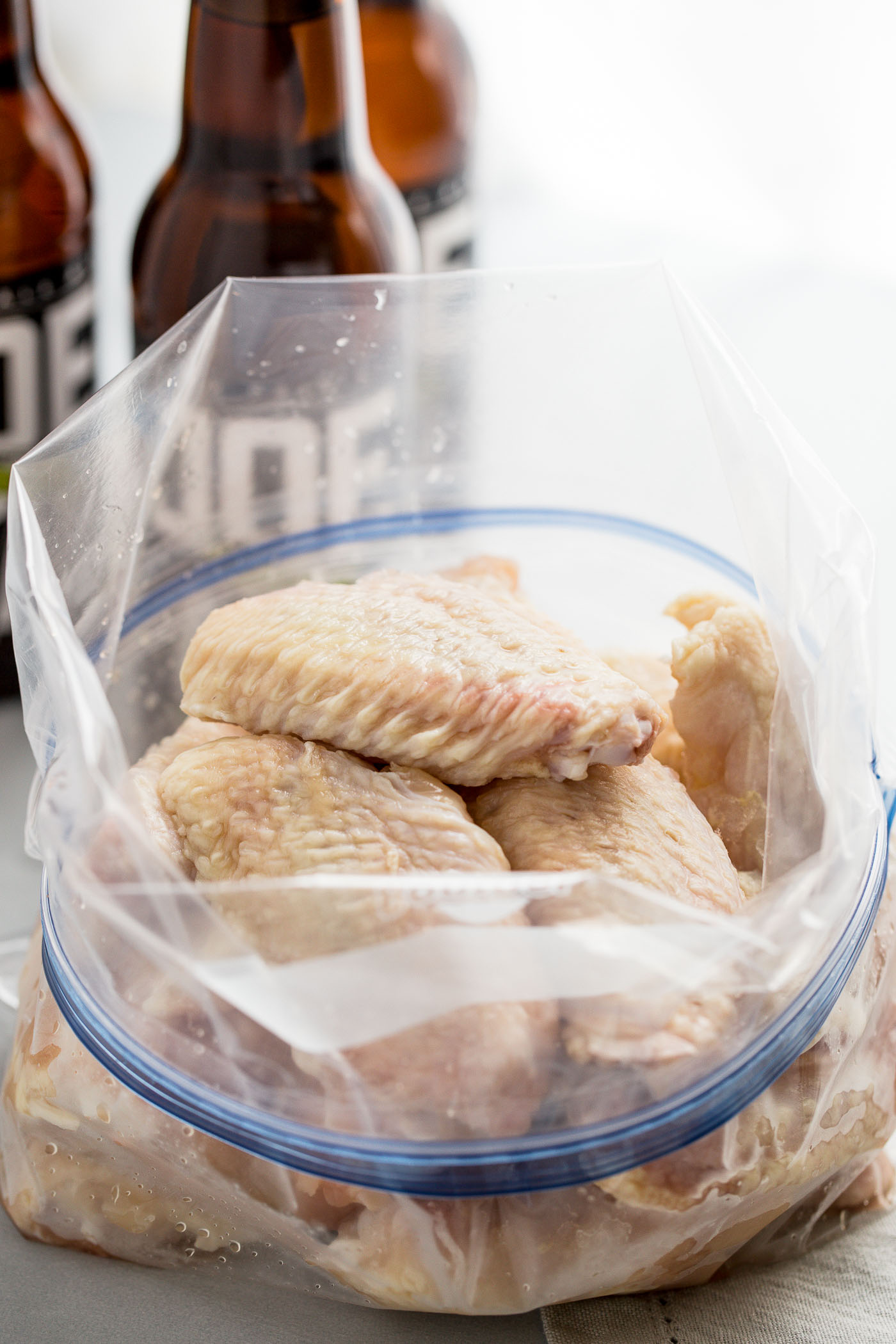 a method & recipe for how to make the perfect grilled buffalo chicken wings. these grilled wings are perfectly crispy & have the best charred buffalo flavor, but they stay juicy from a beer brine. served with a creamy cool feta ranch, grilled wings are perfect for an easy summer dinner when you're having friends over for a summer party, or for game day fun!