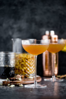 a cozy chai cocktail with golden raisin-infused spiced rum & homemade vanilla chai simple syrup. this chai cocktail is just as perfect for a cozy date night in as it is for celebrating with friends & loved ones this winter season. the perfect cozy winter nightcap. cheers! #playswellwithbutter #chai #rum #hygge #datenightathome #cocktail #cocktailrecipe #wintercocktail #winterdrink #cozycocktail #cozy