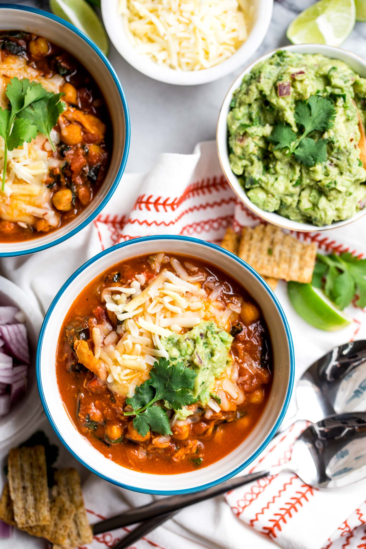 chipotle turkey chili is healthy, comforting, & full of modern flare - smoky heat of chipotle peppers, sweet bites of sweet potato, nutrient-dense kale, & a little touch of cinnamon for some warmth. the perfect cozy comfort food dinner to use up thanksgiving leftovers! #playswellwithbutter #chilirecipe #turkey #comfortfood #thanksgivingleftovers #leftoverturkey