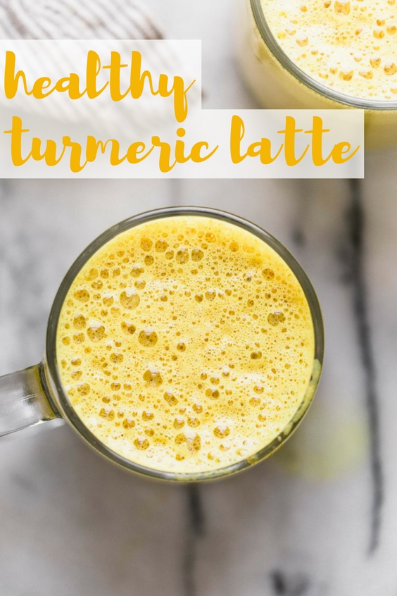 an easy golden turmeric latte recipe that's just as delicious as it is beautiful! this easy golden turmeric latte is loaded with the warm flavors, antioxidants and anti-inflammatory benefits of turmeric, ginger, and cinnamon. great for a calming morning drink, or an afternoon pick-me-up! #goldenlatte #turmericlatte #healthycoffeerecipe #healthybreakfast #homemadelatte #playswellwithbutter