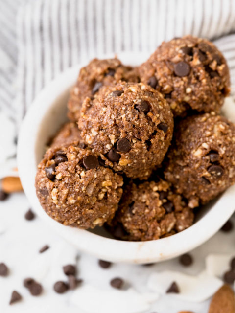 5-ingredient bliss balls couldn't be easier or more wholesome! loaded with dates, cashews, almonds, coconut & dark chocolate, these bliss balls are the perfect little no-bake energy bites to keep on hand as an on-the-go snack during the week or as a healthy little dessert. #energrybites #blissballs #chocolatecoconut #healthysnack #healthydessert
