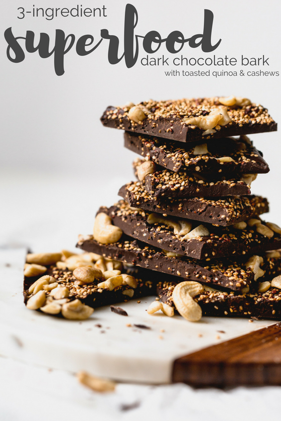 a simple & healthy three-ingredient dark chocolate bark recipe with toasted quinoa folded throughout a thick layer of dark chocolate and topped with cashews. this superfood dark chocolate bark has it all - plant-based protein, antioxidants, & healthy fats - what more could you want out of a healthy little on-the-go snack or dessert? #darkchocolatebark #chocolatebarkrecipe #healthychocolatebark #healthydessert #superfoodsnacks #healthysnack #toastedquinoa #cashews #darkchocolate