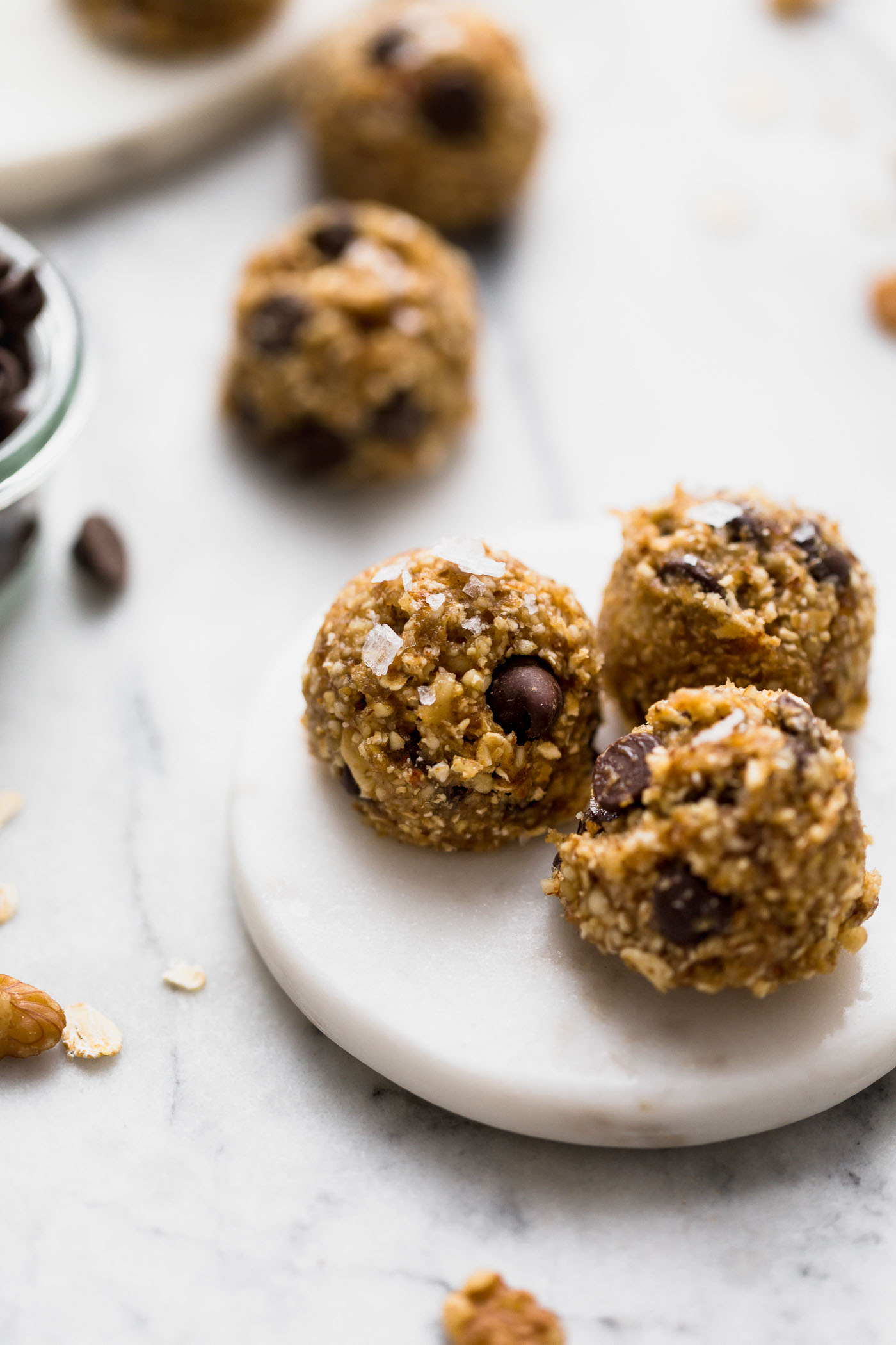 chocolate chip banana bread bliss balls are an easy & totally wholesome snack! inspired by chocolate chip banana bread, but in the form of a healthy, raw energy bite, these chocolate chip banana bread bliss balls are loaded with dates, cashews, almonds, walnuts, and banana. #playswellwithbutter #blissballs #energybites #healthysnack #healthydessert #healthyrecipe #bananabreadbites #bananabread