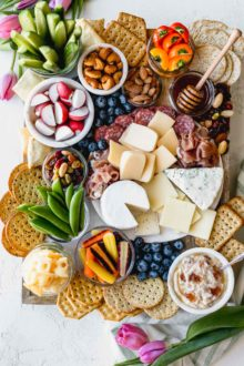 building a stunning & delicious ultimate cheese board on a budget couldn't be easier when you take advantage of the low prices at aldi! this ultimate aldi cheese board is inspired by springtime with a variety of cheeses, crackers, veggies, & nuts, & is perfect for any spring celebration - mother's day, father's day, graduation parties, bridal showers, or spring brunches! #playswellwithbutter #cheeseboard #howtomakeacheeseboard #easycheeseboard #cheeseboardideas #springcheeseboard #bridalshoweridea #appetizeridea #appetizerrecipe #aldirecipe #whattobuyataldi #aldifinds