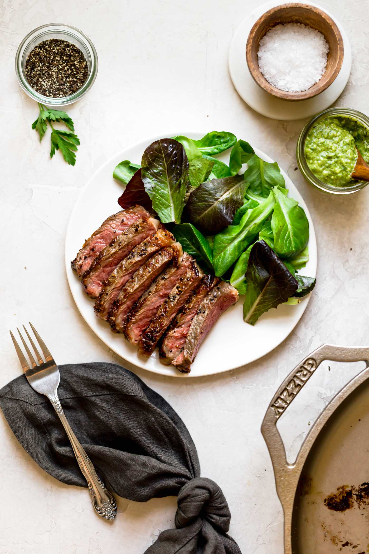 a cast iron steak recipe to show you how to cook steakhouse quality steaks at home. you only need 5 ingredients, 3 minutes, & 1 great skillet to cook a perfectly medium rare cast iron steak on your stove top - how easy is that?! #playswellwithbutter #castironsteak #easysteakrecipe #steakhousesteakrecipe #castironrecipe