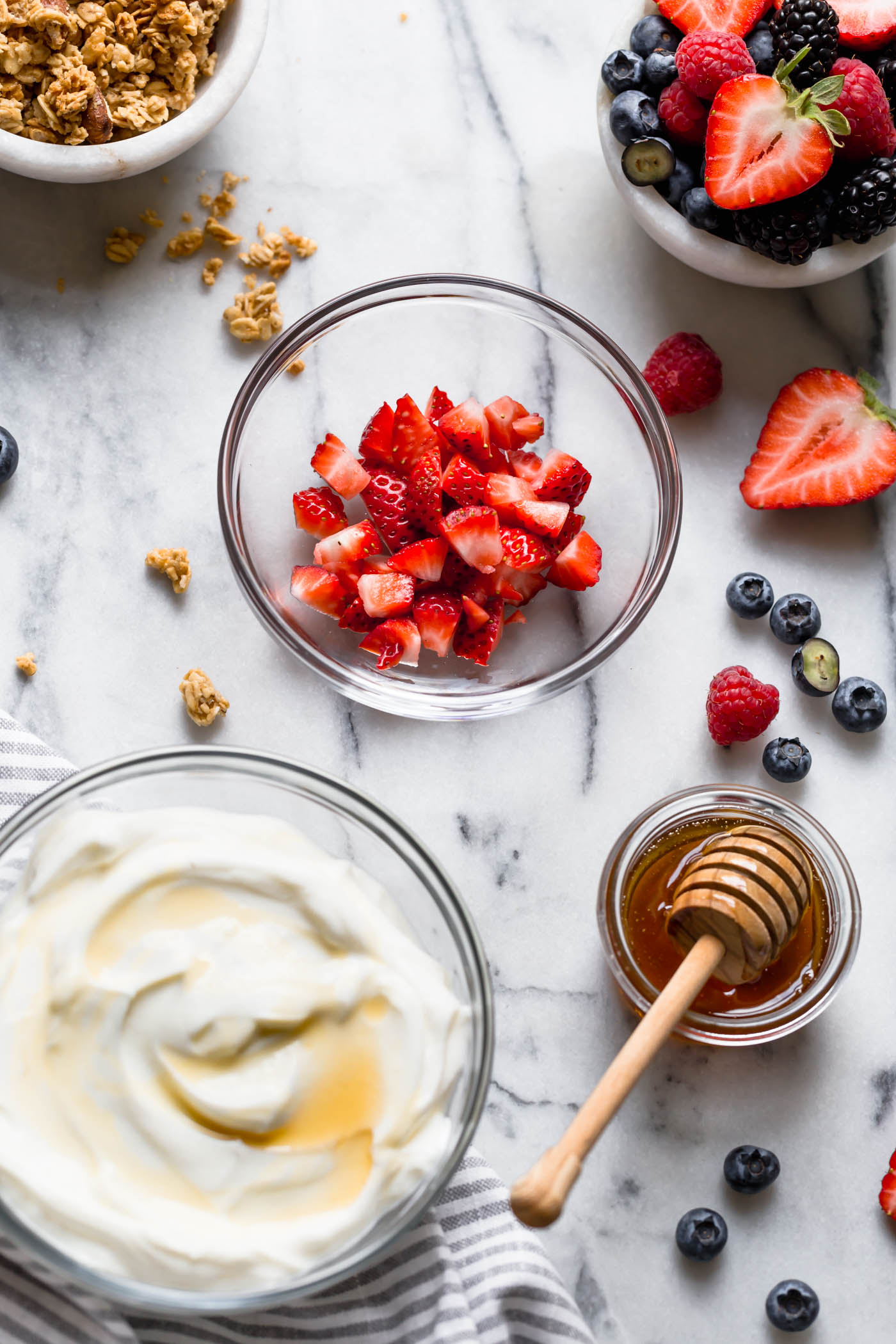 easy & healthy frozen yogurt bites call for only 5 ingredients and 10 minutes of active prep time! with wholesome ingredients like greek yogurt, fruit, honey, and your favorite granola, these frozen yogurt bites are as healthy as they are delicious - the best little treat to keep in your freezer this summer! #playswellwithbutter #frozenyogurtbites #frozenyogurt #greekyogurt #healthysnack #glutenfreerecipe #summertreats #summerdesserts