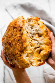 a foolproof recipe for making no-knead spicy cheese bread at home in a dutch oven like a pro! no-knead spicy cheese bread is ridiculously easy to make (only 10 minutes of prep & 5 ingredients needed!), & it's especially ridiculously easy to eat. great with soup, chili, to serve at a tailgate party, or just as a snack! #playswellwithbutter #nokneadbread #cheesebread #easybreadrecipe #dutchovenbread #stellascheesebread #spicycheesebread #wisconsinrecipe