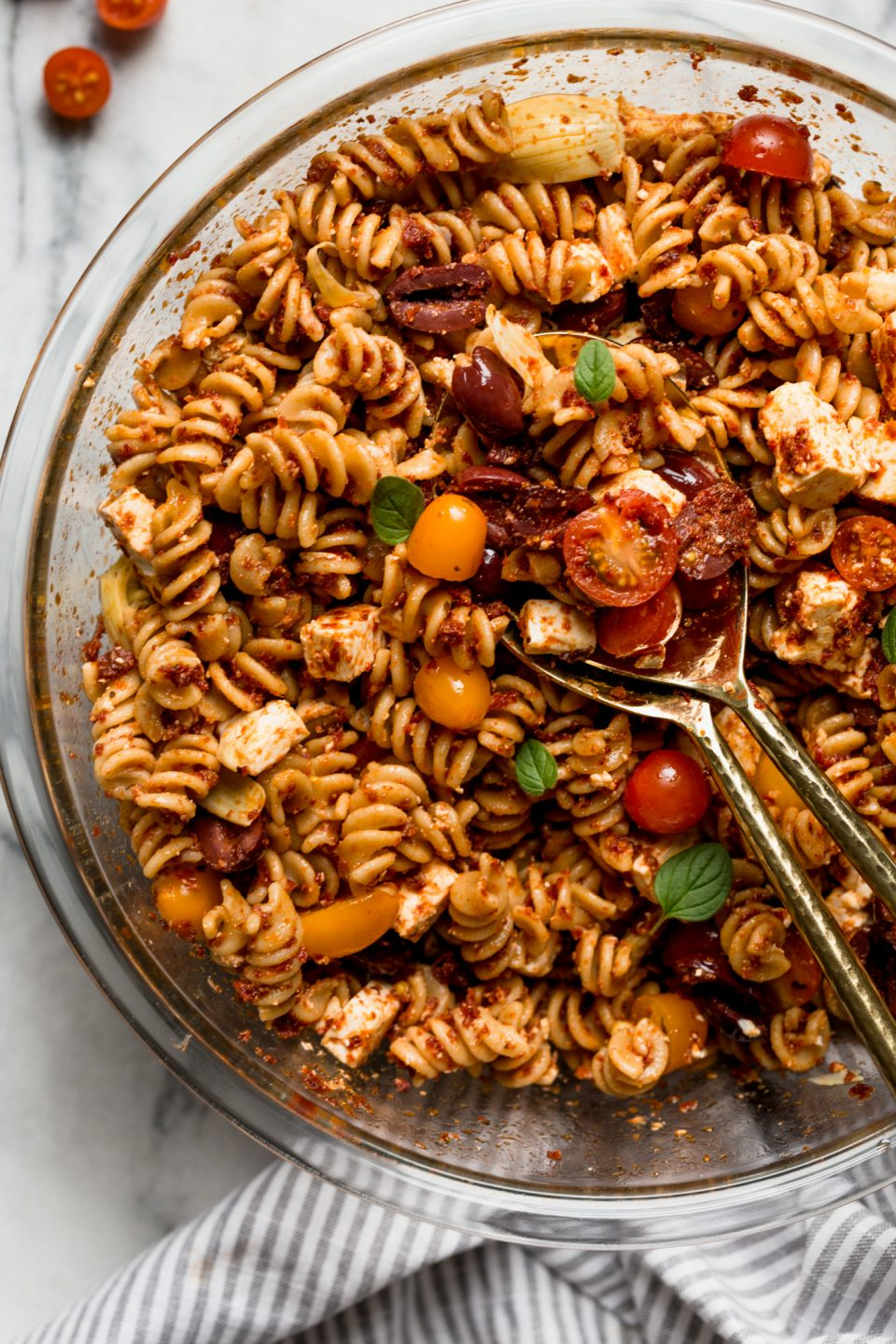 sundried tomato pasta salad with fresh tomatoes in a bowl