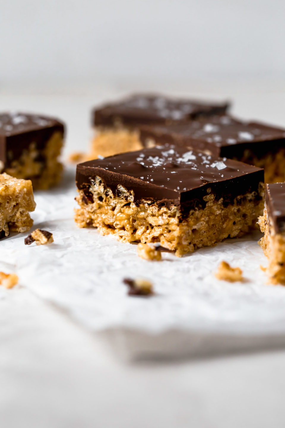 tahini scotcheroos are an update on the classic no-bake summertime dessert we all know & love! these tahini scotcheroos are an allergy-friendly (gluten free, nut free), easy to make treat & they're perfect for feeding a crowd! #playswellwithbutter #scotcheroos #scotcheroosrecipe #dessert #nobakedessert #nobakebars #allergyfriendly #glutenfreedessert #nutfreedessert