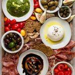 the ultimate burrata cheese board!!! this burrata cheese board has burrata three ways (truffle! balsamic! pesto!) & served alongside all the best cheese board snacks. the perfect easy & totally impressive party snack or dish to share whenever you're entertaining! #playswellwithbutter #burrata #burrataappetizers #howtoserveburrata #cheeseboard #partyfood #partyappetizers #cheeseboardideas #easycheeseboard #howtomakeacheeseboard