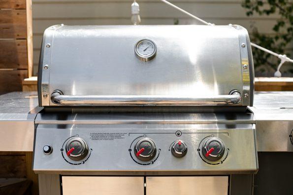 Weber Genesis II Propane Grill on a deck.