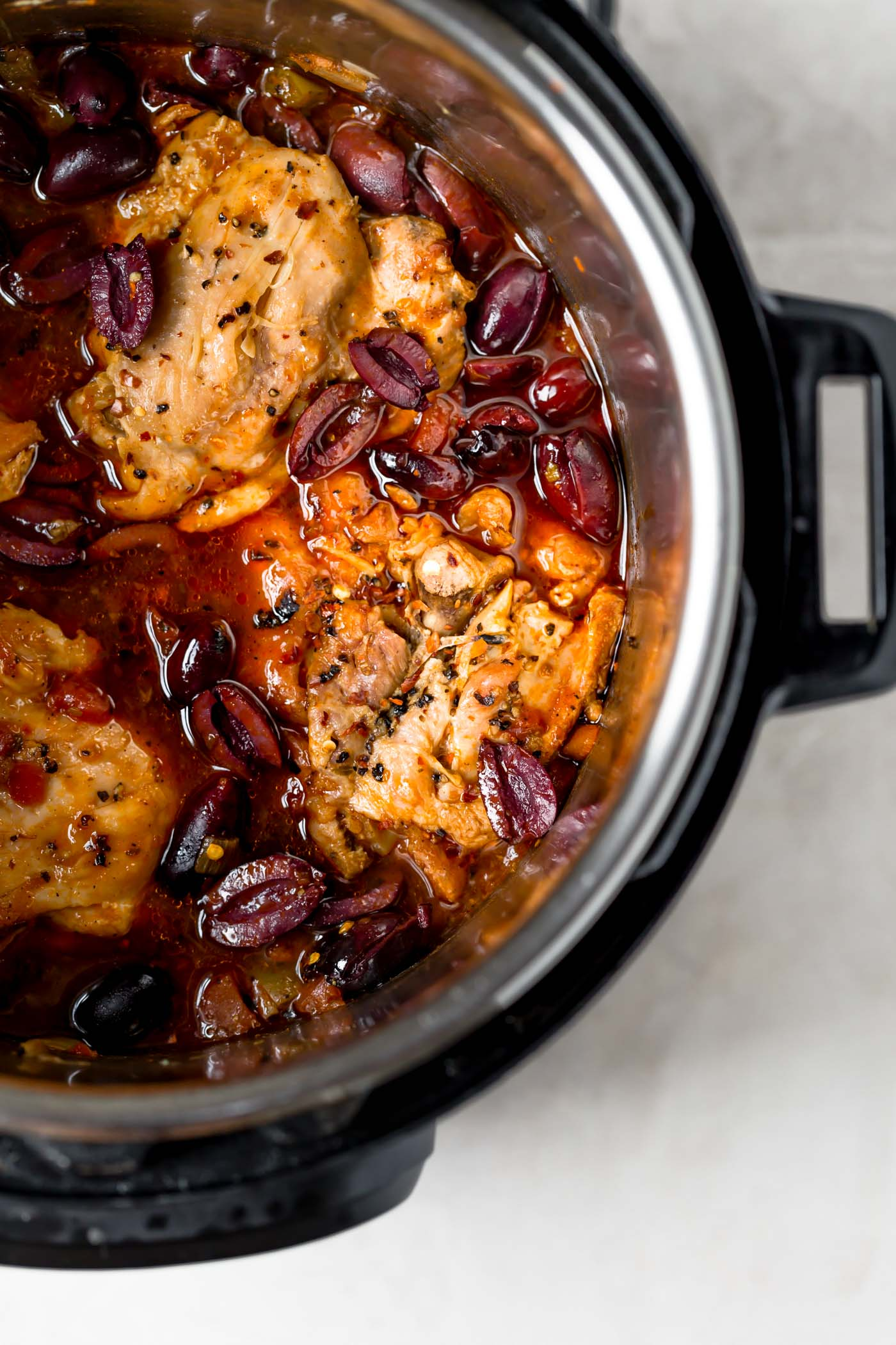 "instant pot chicken cacciatore will be your new favorite weeknight dinner! with tomatoes, peppers, mushrooms, & wine, this chicken cacciatore recipe offers all of the rich, traditional flavor of authentic italian ""hunter-style"" braised chicken, but is made so, so easy by using the instant pot! #playswellwithbutter #chickencacciatore #easychickencacciatorerecipe #instantpotrecipe #instantpotrecipesforbeginners #authenticitalianrecipes #italianrecipeswithchicken"