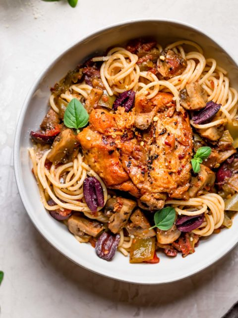 """instant pot chicken cacciatore will be your new favorite weeknight dinner! with tomatoes, peppers, mushrooms, & wine, this chicken cacciatore recipe offers all of the rich, traditional flavor of authentic italian """"hunter-style"""" braised chicken, but is made so, so easy by using the instant pot! #playswellwithbutter #chickencacciatore #easychickencacciatorerecipe #instantpotrecipe #instantpotrecipesforbeginners #authenticitalianrecipes #italianrecipeswithchicken"""