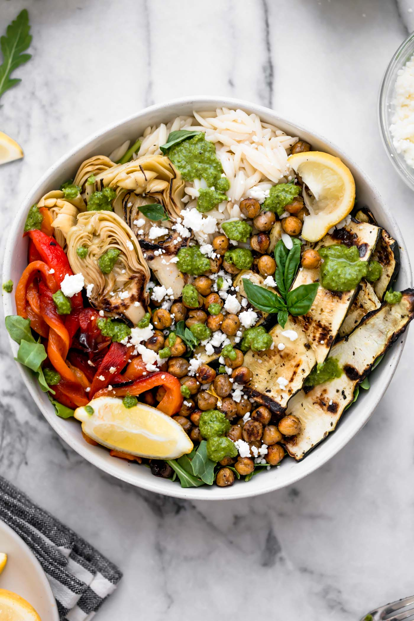 grilled vegetable primavera bowls with pesto & smoky chickpeas! an easy 30-minute vegetarian recipe perfect for the end of summer, with grilled zucchini, grilled bell pepper, grilled artichoke hearts, and smoky grilled chickpeas, plus orzo & lemony pesto. totally healthy, naturally plant-based, easily made gluten-free, & perfect for meal prep! #playswellwithbutter #vegetableprimavera #vegetablerecipes #healthyvegetableprimavera #easydinnerrecipes #healthyvegetarianrecipes #vegetarianmealprep #zucchinirecipes #mealpreprecipes