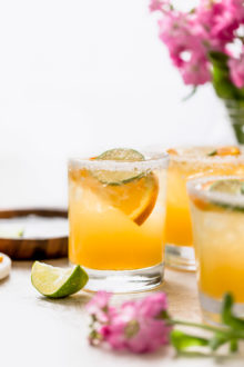 refined sugar-free margaritas are the perfect light & refreshing cocktail! this simple margarita recipe is made without triple sec, using the freshest ingredients instead: fresh lime juice & fresh orange juice, with a little maple syrup to sweeten things up slightly. a modern take on the skinny margarita and a classic margarita on the rocks, say hello to the best margarita recipe & get those chips & guac ready!!! #playswellwithbutter #classicmargaritarecipe #skinnymargaritarecipe #refinedsugarfreerecipes #margaritaontherocks #tequila #maplesyrup #summercocktail #easycocktail