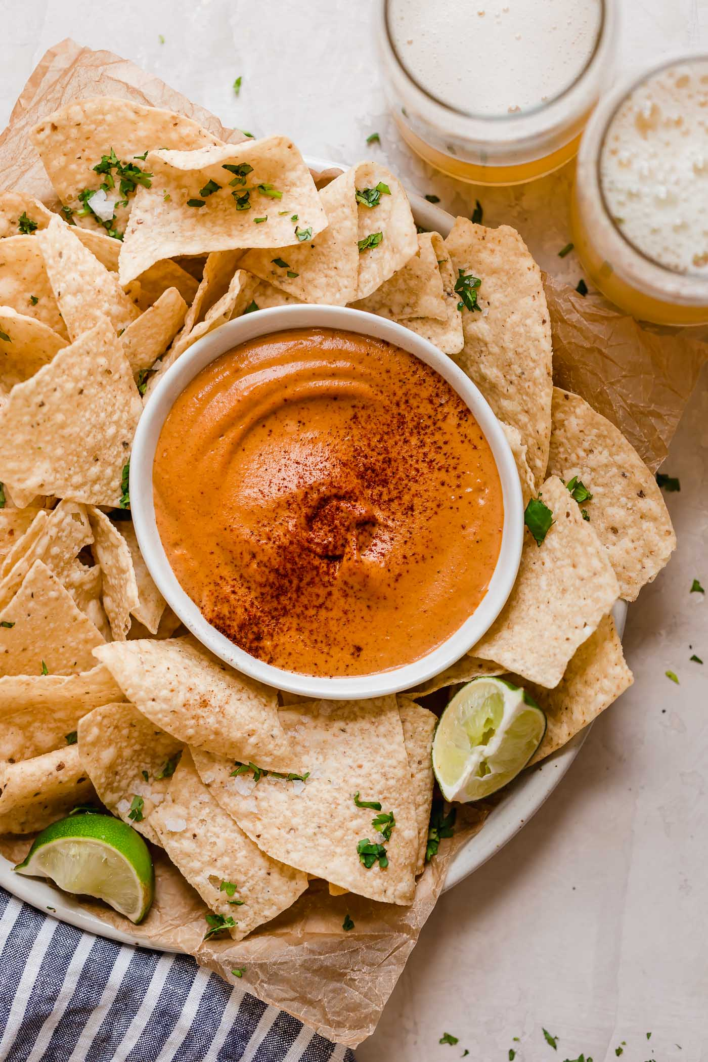smoky chipotle cashew queso! an easy vegan queso recipe made with cashews, chipotle peppers, spices, & lime juice! the perfect healthy game day snack, smoky chipotle cashew queso will be the hit of your next game day party! #playswellwithbutter #cashewqueso #veganqueso #easyveganrecipes #vegansnack #gamedaysnacks #gamedayappetizer #gamedayfood #healthysnack