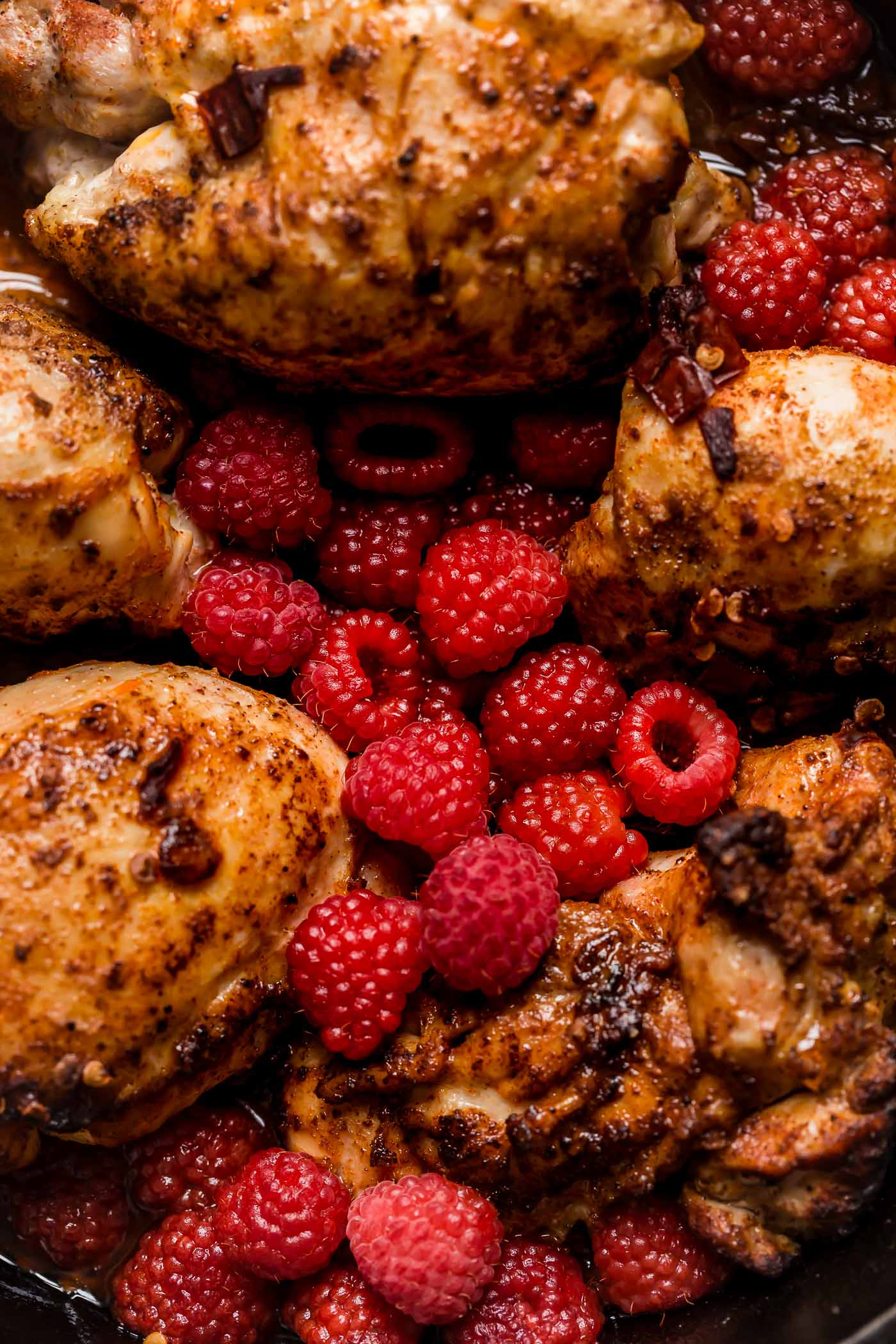 an easy one-skillet recipe for chipotle raspberry chicken, served overtop an autumn hummus bowl with creamy, garlicky hummus, finely shredded kale, wild rice, goat cheese, & some extra raspberries. chipotle raspberry chicken autumn hummus bowls are the perfect healthy & easy weeknight dinner, or an easy meal to prep for grab-&-go lunches this week! #hummusbowl #chipotleraspberrychicken #raspberryrecipes #raspberrydinnerrecipes #healthyrecipe #skilletrecipe #bowlrecipe #easyrecipe #mealprep