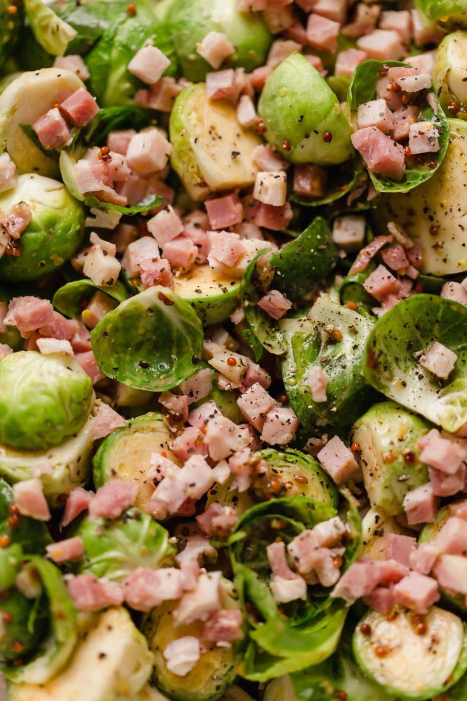 Brussels sprouts with pancetta, tossed in a maple mustard roasting sauce before being roasted.