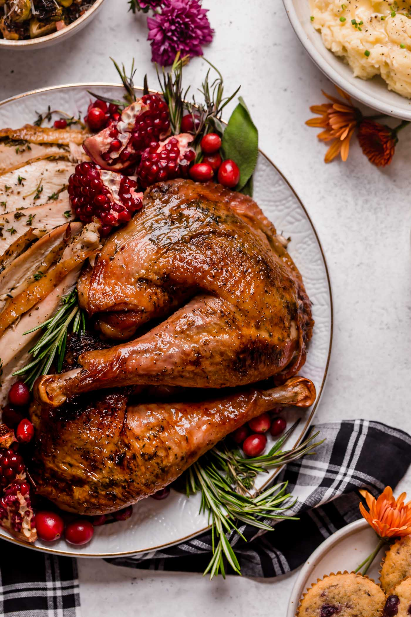 maple glazed spatchcock turkey. spatchcock turkey gets slathered in an easy-to-make maple herb butter, then roasted & finished with a maple glaze. the perfect thanksgiving flavors, in one easy turkey recipe! roasting a juicy & moist thanksgiving turkey has never been easier, especially thanks to @Honeysuckle White turkey (#ad)! #playswellwithbutter #turkeyrecipe #thanksgivingturkey #moistturkeyrecipe #bestthanksgivingturkeyrecipe #spatchcock #spatchcockturkey