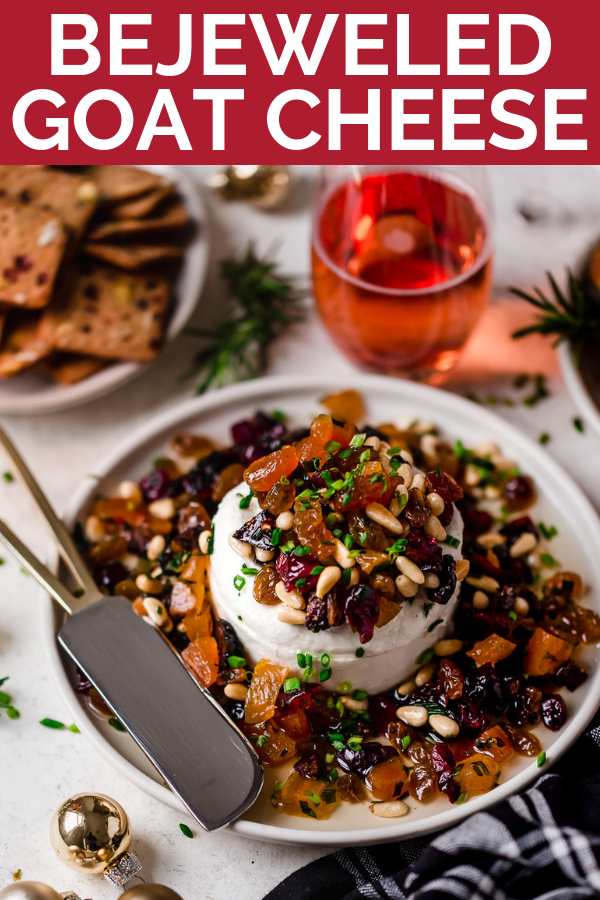 bejeweled holiday marinated goat cheese. easy & beautiful appetizer for any holiday party, this bejeweled holiday marinated goat cheese is always a total show stopper. dried fruits (apricots, golden raisins, figs, cranberries) marinated with fresh herbs & pine nuts, then served over a generous portion of goat cheese. this marinated goat cheese recipe only takes 10 minutes to prep & is always a hit! #playswellwithbutter #marinatedgoatcheese #cheeseball #holidayappetizers #crowdpleaserappetizer
