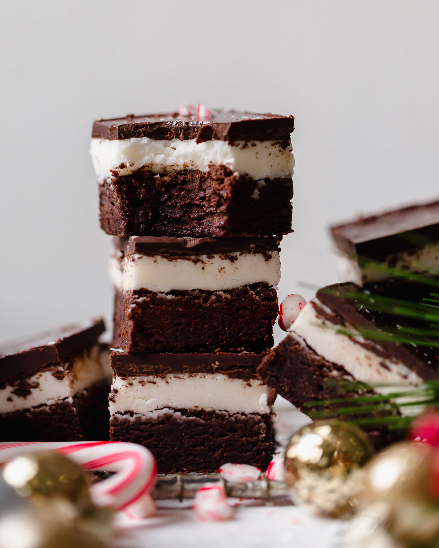dark chocolate peppermint brownies recipe. extra fudgy dark chocolate brownies topped with homemade peppermint frosting & an easy chocolate glaze. the ultimate easy recipe for a festive holiday dessert! #mintbrowniesrecipe #classicmintbrownies #mintbrowniesfromscratch #mintfrosting #bestmintbrownies #christmascookies #christmasdesserts #darkchocolate #browniesfromscratch #brownieseasy #holidaybaking