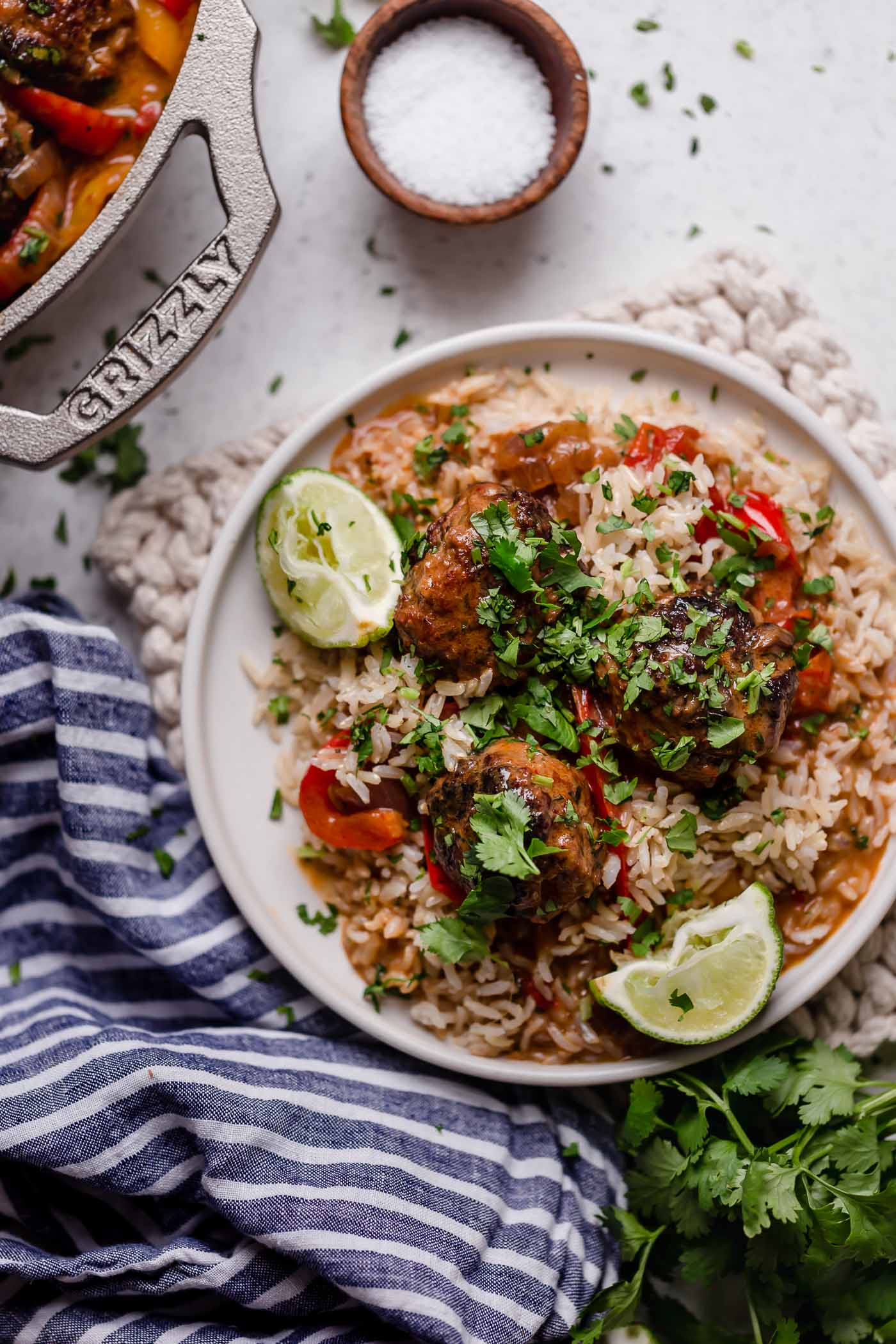 skillet red curry with ginger turkey meatballs. the creamiest red curry with onions, bell peppers, & flavorful turkey meatballs made with tons of ginger, garlic & cilantro - & the best part is it's all made in one pan! an easy & comforting skillet red curry recipe! #playswellwithbutter #redcurry #easyredcurry #turkeymeatballs #gingermeatballs #healthyrecipe #castiron #skilletrecipe #onepandinners #onepanmeal #castironrecipe