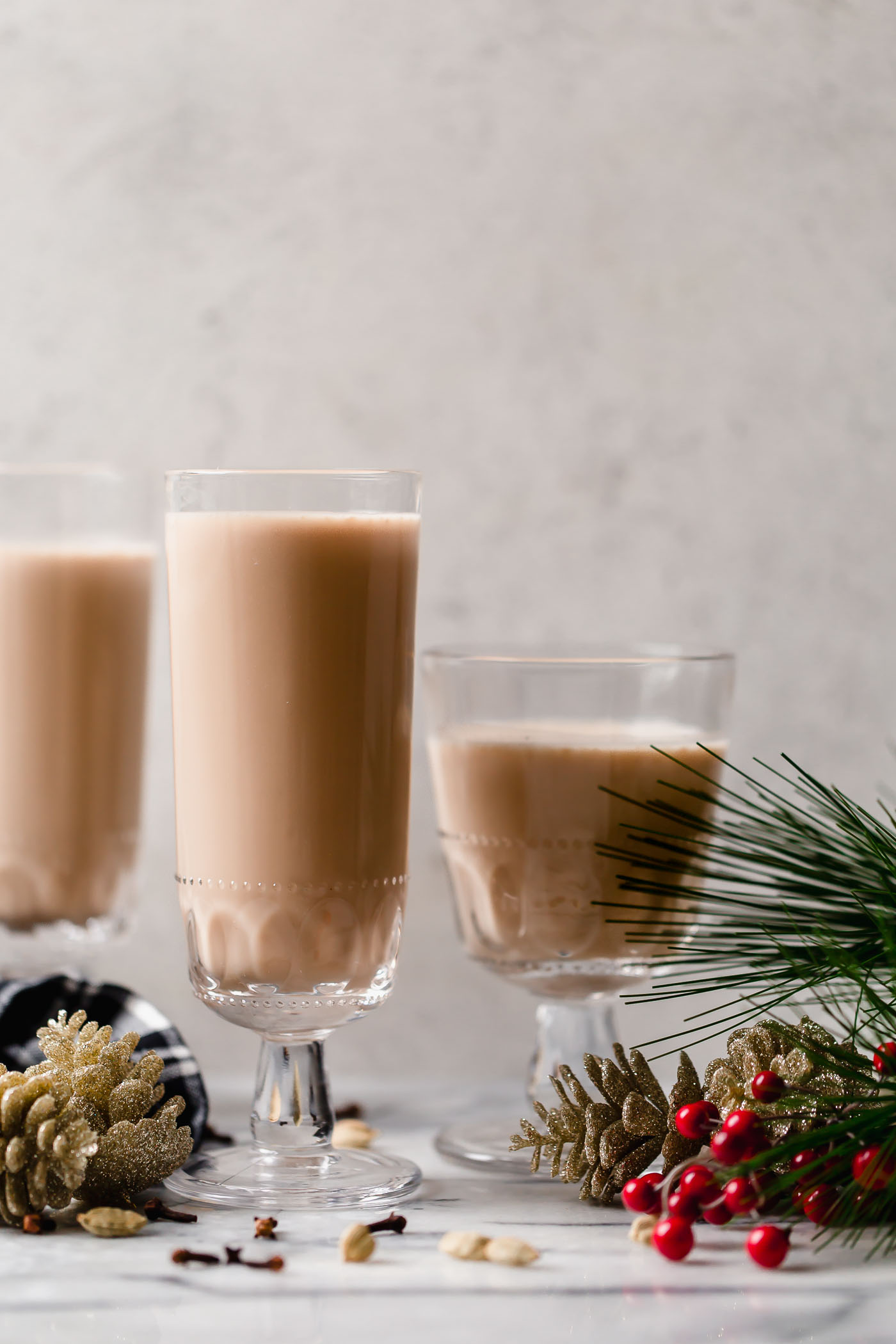 smoky spiked coconut chai tea latte. an easy spiked chai tea recipe! a coconut chai tea latte, lightly sweetened with maple syrup & spiked with mezcal & tequila. an easy & cozy boozy chai tea that's perfect to warm up on a cold winter night during the holiday season. #playswellwithbutter #spikedchaitea #spikedchailatte #spikedchai #chaicocktail #coconutchai #easycocktailrecipes #fallcocktailrecipes #wintercocktailrecipes #holidaycocktailrecipes #christmascocktailrecipes #mezcalcocktails