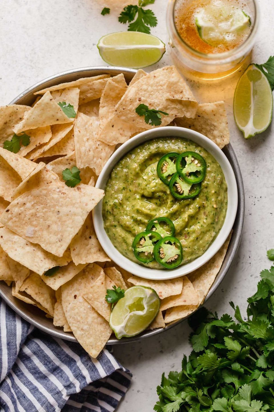 a classic salsa verde recipe with a twist, this creamy salsa verde is full of bright flavors (from tomatillos, peppers, cilantro, & lime juice), & gets tons of creaminess from avocado. this creamy salsa verde recipe is easy to make, & even easier to eat! say hello to your new favorite game day snack! #playswellwithbutter #salsaverde #easysalsaverderecipe #creamysalsaverde #tomatillosalsa #tomatillorecipes #tomatillosauce #easyveganrecipes #vegansnack #gamedaysnacks #gamedayappetizer #gamedayfood