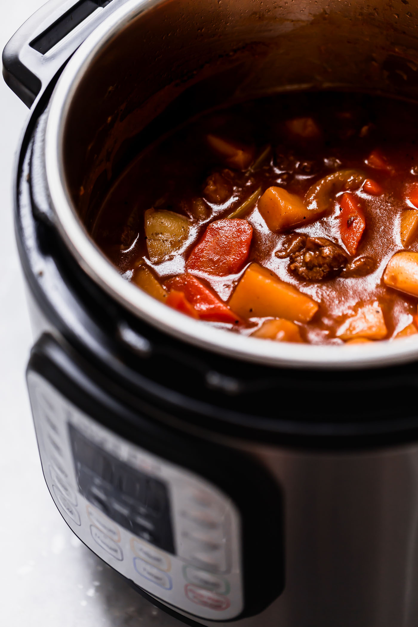 instant pot hawaiian beef stew. my hawaiian grandpa's famous island beef stew, made in the instant pot for extra convenience! this instant pot hawaiian beef stew is total comfort food: a tangy & rich tomato gravy filled with perfectly tender pieces of beef, onions, carrots, & potatoes. served over a bed of sticky rice, this instant pot hawaiian beef stew is the perfect comforting dinner! #playswellwithbutter #hawaiianbeefstew #instantpothawaiianbeefstew #beefstew #instantpotbeefstew #localhawaiianrecipe #authentichawaiianrecipe #easybeefstewrecipe #comfortfood #comfortfoodrecipes #comfortfooddinners