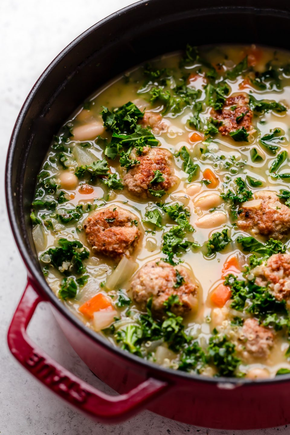 Healthy Italian wedding soup shown in a small dutch oven.