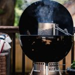 A Weber Charcoal grill with a charcoal chimney with graphic text overlay for Pinterest.
