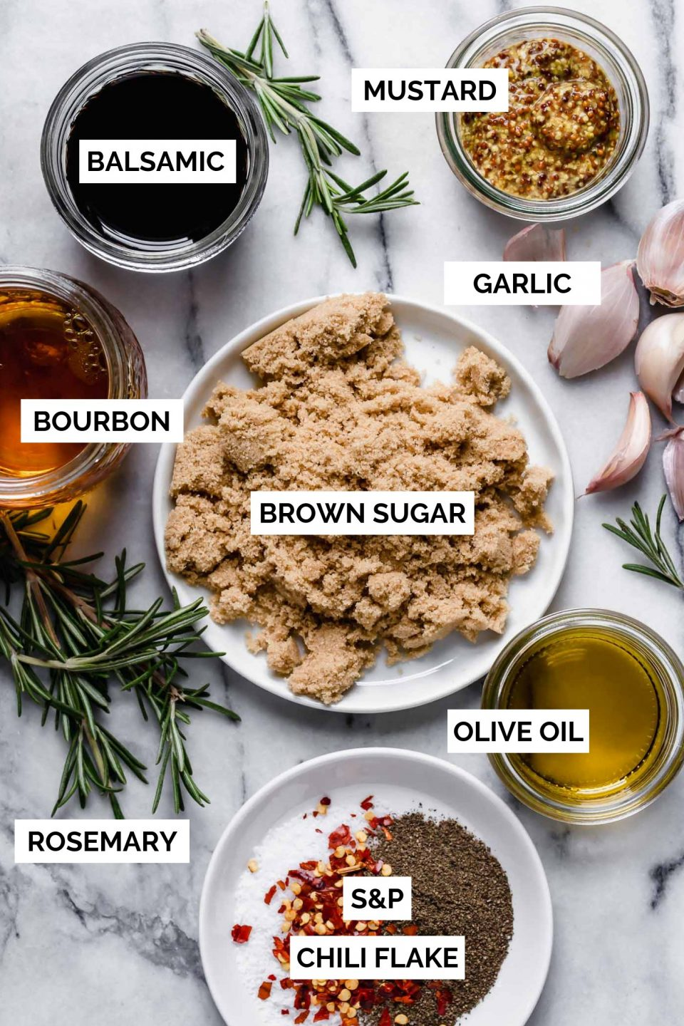 Brown sugar bourbon marinade ingredients arranged in multiple jars to show how to make brown sugar bourbon marinade