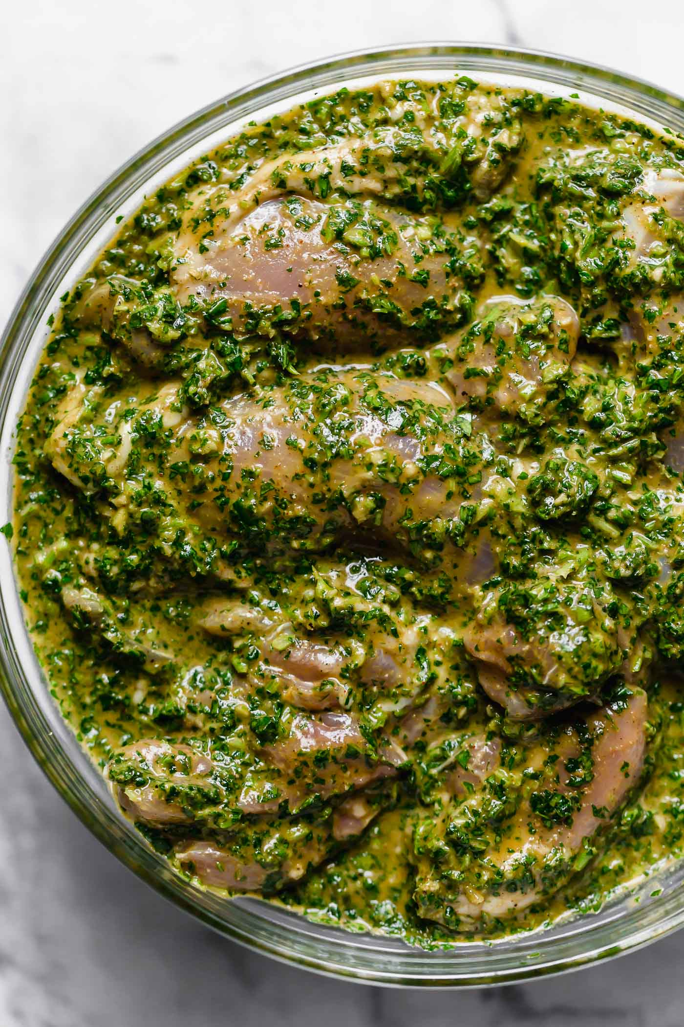 Similar to chimichurri, chermoula is packed with garlic & punchy fresh herbs (like cilantro, parsley, mint), but it also has a hint of warmth from spices common in North African & Middle Eastern cooking (cumin & coriander ftw!). It's traditionally served over grilled fish...but I'm pretty sure once you have it you'll want to put it on everythaaang. #playswellwithbutter #chermoula #chermoulasauce #morrocanfood #morrocanrecipes #marinaderecipe #easymarinade #grillingrecipes #chickenmarinade