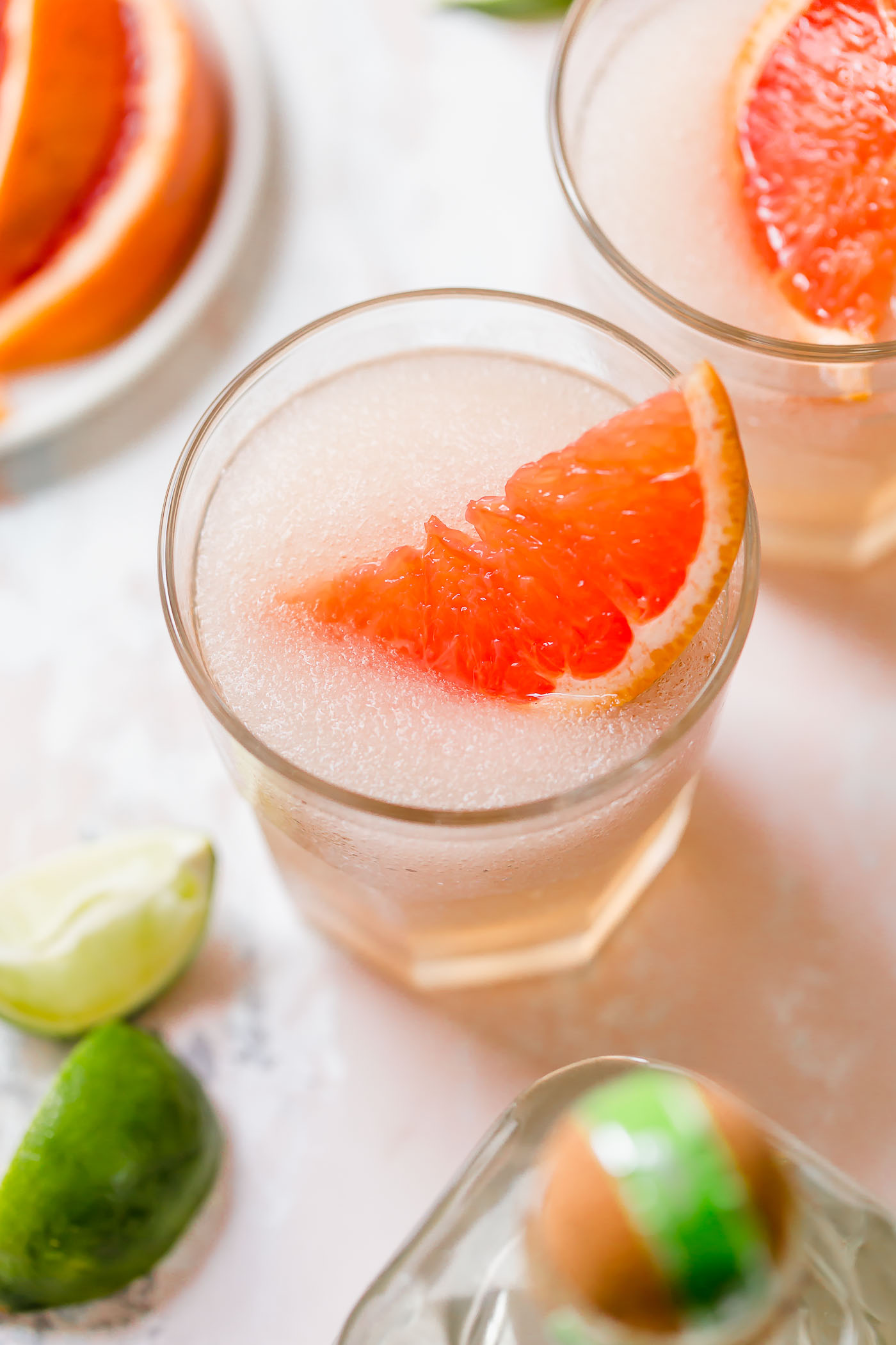 frose palomas in glass with grapefruit garnish