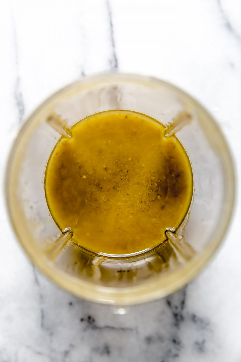Easy Greek Dressing in blender cup, after blending.